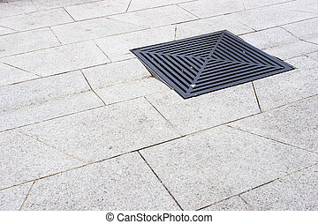 Drain - Photo of a Street Drain