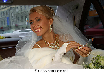 Happy Bride - The beautiful bride in the automobile. The...