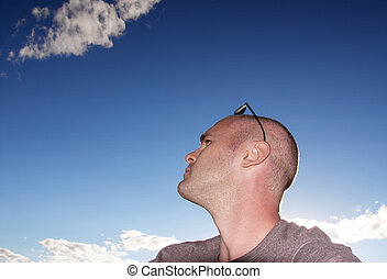 Man in clouds - male with shaved head