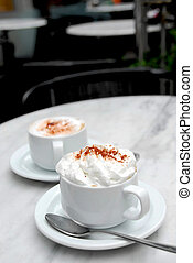 Coffee cup - Two cups of specialty coffee on a table in a...