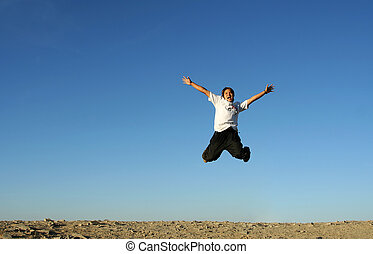 Happy man - A man jumping in the air