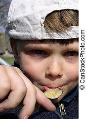 Boy Eating Honey - A boy eating honey