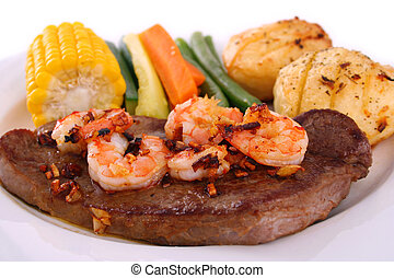Steak and seafood - A steak with garlic butter sauce and...