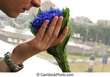 Cornflowers - The man holds a bouquet from cornflowers on a...