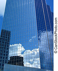 Business Competition - clouds and nearby buildings reflected...