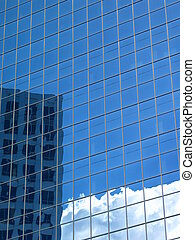 Competition - Blue office building reflecting clouds and the...