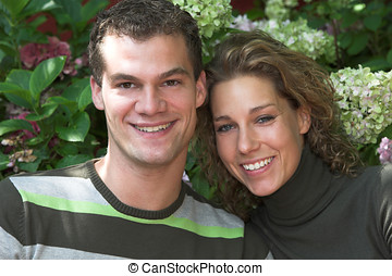 In the garden - Lovely young couple together in the garden
