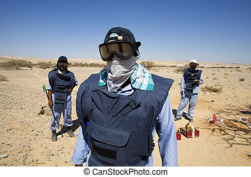 deminers - deminer in action cleaning the area from mines