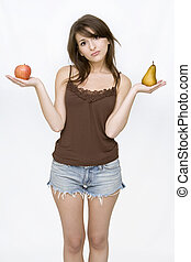 girl posing holding pear and an apple - beautiful girl...