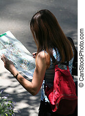 Woman reading a map, looking like she is lost