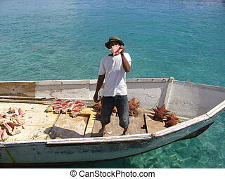 Man selling conch - A man selling conch shells in an old...