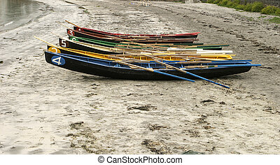 Rowboats On The Beach - Six numbered and brightly colored...