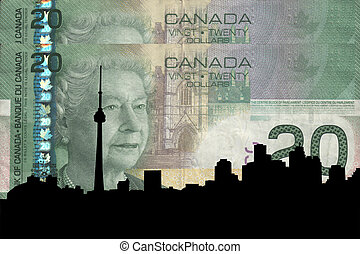 Toronto skyline against Canadian 20 dollar note