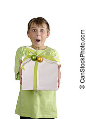 Excited boy holding a wrapped present - Excited wide eyed...