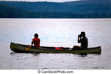 Couple in canoe - Couple in a canoe on a lake