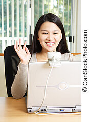 Businesswoman - A businesswoman using webcam for meeting