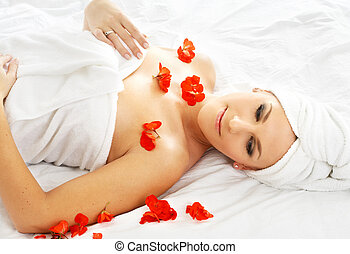 red petals spa - beautiful lady with red flower in spa