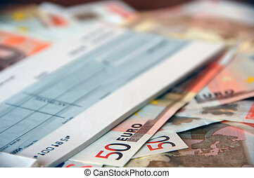 cheque on euros - business cheque-book on a pile of euro...