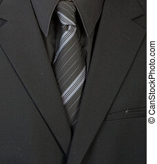 A closeup of a mans well dressed attire. - Classy...