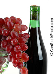 Grapes and Wine - bunch of red grapes in a wine glass with a...