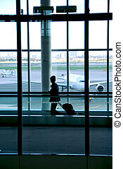 Woman airport - Woman walking in the airport with luggage