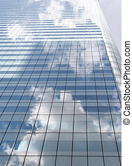 Modern office building - clouds reflected in modern office...