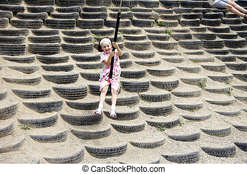 young girl swinging 05
