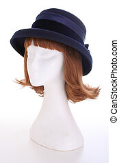 Ladies blue hat - A blue ladies hat on a white manequin...