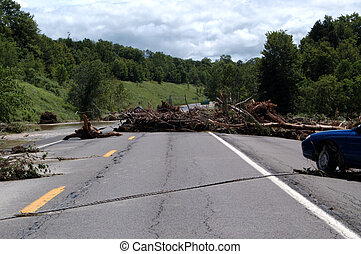 Debris in road - Debris stretched across a paved roadway...