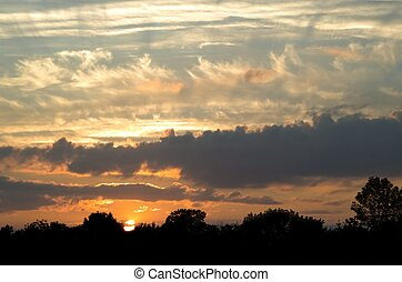 Cloudy Sunset - A variety of dramatic cloud formations makes...