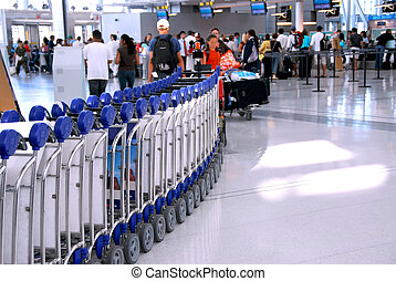 Airport crowd - Passengers lining up at the check-in counter...