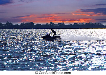 Jetski - Man on jet ski at sunset
