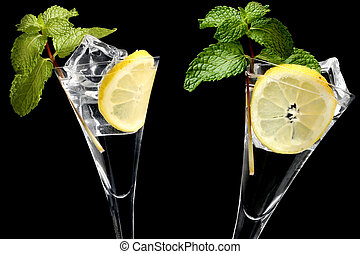 Mojitos Over Black - Mojito cocktails over black background