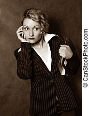Business woman - The beautiful girl with the phone and the...