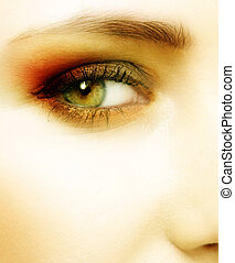 green eye of a woman - green eye with dramatic red and...