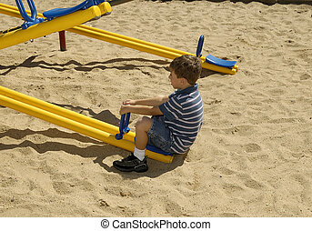 Seesaw - Photo of a Young Boy on a Seesaw