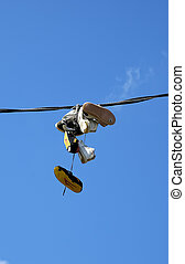 Hanging Sneakers - Photo of SNeakers Hanging From an...