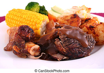 Roast lamb - A roast lamb dinner with vegetables on a white...