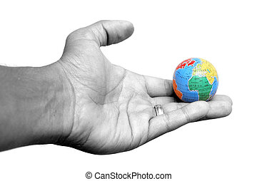 Hand and Earth - Hand holding globe of the Earth