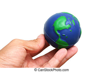 Hand and Globe - Finger tips holding globe of the earth over...
