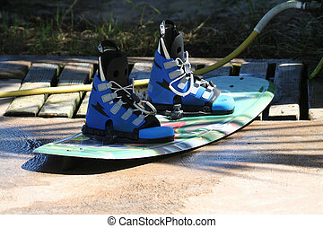 wakeboard on a pier, after cleaning