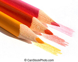 Colored pencils - Three colored pencils on white paper sheet