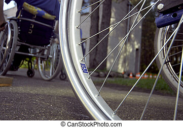 Wheelchairs - Two wheelchairs and handicap sign