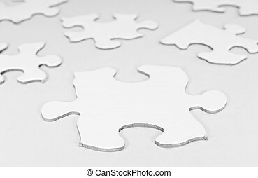 Puzzle Pieces - Black and White Photo of Puzzle Pieces