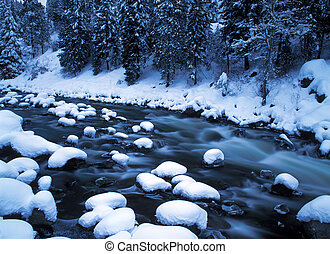 snowy river - deep fresh snow covers rocks in white water...