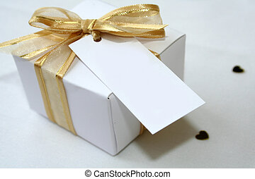 Gift Box - A gold and white gift box with a blank label