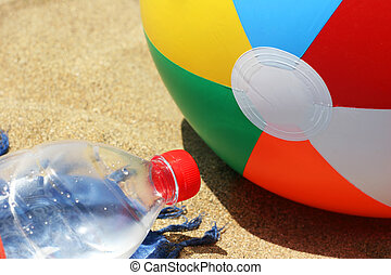 Beach Detail - Beach ball and water bottle on the beach
