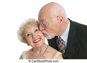 Kisses and Giggles - A pretty senior woman giggling as her...