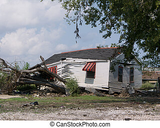 Hurricane Katrina - Lower Ninth Ward - a house rests on a...