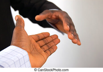 Completed Deal - This is an image of a two hands about to...